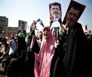 Supporters of ousted Egypt's President Mohammed Morsi chant slogans during a rally in Nasr City,Cairo