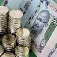 Rupee, bonds fall after RBI raises repo rate