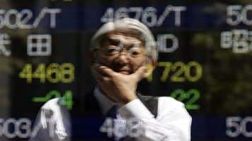 Asia up on Wall Street's lead, dollar holds gains