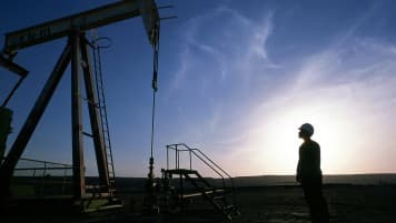 Brent climbs by over $1 on crude stock draw, US eco data