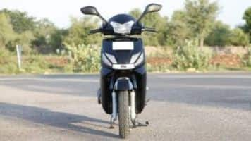 Mahindra unveils racing bike, electric 2-wheeler
