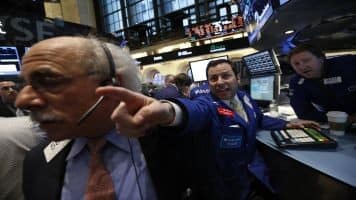 Wall St falls on Greek default fears, volatility spikes