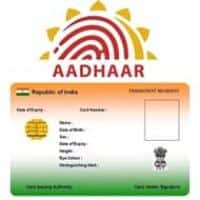 Panel suggests free Aadhar-based A/c for all Indians by '15