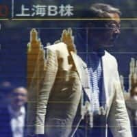 Asian shares slump as Ukraine tensions flare