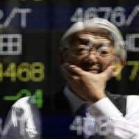 Asian shares mixed, but Aussie firms on Australia Q4 GDP