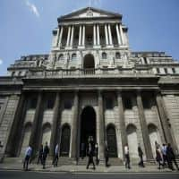 Bank of England cuts rate for 1st time in over 7 years to 0.25%