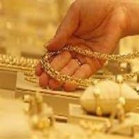 Gold holds above $1,300 on Ukraine; fund outflows pose risk