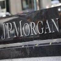 JPMorgan says reducing 2014 profit target, jobs