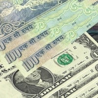 Rupee opens higher at 67.06 per dollar