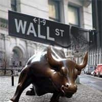 Wall Street ends lower on China data; financials drag