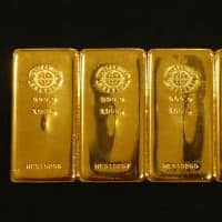 Gold holds below $1,200 due to firmer dollar, equities