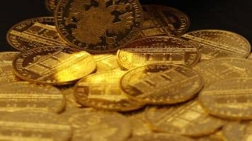 Gold rises Rs 50 in futures trade on global cues