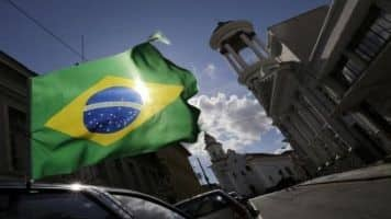 Brazil downgraded to 'junk' rating by S&P, deepening woes