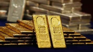 Gold holds up on weak equities, platinum near seven-year low