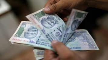 Rupee opens marginally lower at 64.87 per dollar