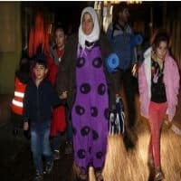 Migrants stream into Austria, swept west by Hungary