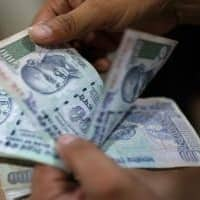 Rupee opens higher at 67.53 per dollar