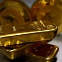 Gold hits 7-week low as Fed rate hike prospects boost dollar