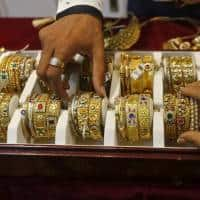 Gold drops three-week low as investors look to equities