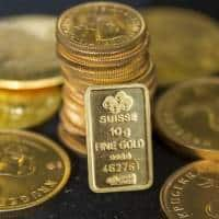 Gold holds on to overnight gains as stocks, dollar retreat
