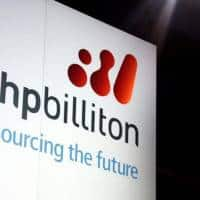 BHP Billiton books record loss, sees good growth in 2017