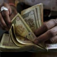 Chinese yuan, India rupee to fall as US Fed hike risks rise:Poll