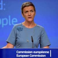 EU's Margrethe Vestager warns others, says Apple could cut bill