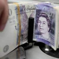 Worst four days since June push sterling below $1.23