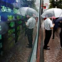 Asia stocks, dollar edge up after China-induced fall