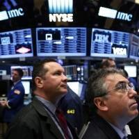Wall St extends record streak, Dow breaks 19,000 for 1st time