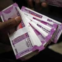 Rupee's slide from outflows, demonetization likely near end:Poll