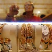 Gold down on US rate hike expectations; ECB meeting in focus