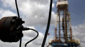 Oil prices dip on strong dollar, firm global supplies