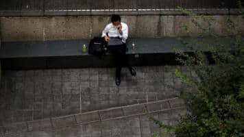 Japan business sentiment mixed in fragile recovery