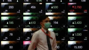 Asian shares mostly lower, oil near 1-year high