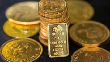Gold drops to 5-month low as dollar strengthens