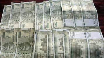Rupee opens lower at 66.94 per dollar