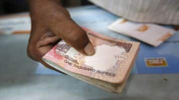 Rupee opens marginally higher at 66.48 per dollar