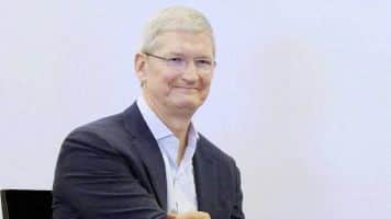 Apple cuts Tim Cook's pay as iPhone sales fall first time