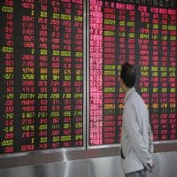 Asian shares ease, taking cue from Wall Street, oil slips