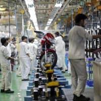 Honda Motor, HDFC ERGO tie up for 2-wheeler insurance
