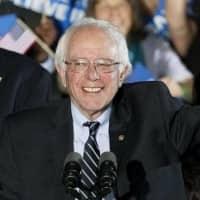 Trump, Sanders ride anti-establishment tide to New Hampshire win