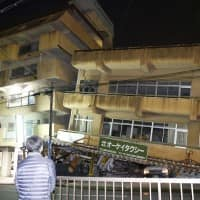 Japan quake rattles mkts as firms shut; survivors queue for food