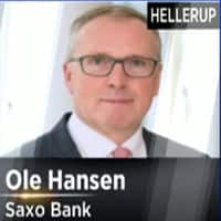 Inventory overhang likely to push crude prices down: Saxo Bank