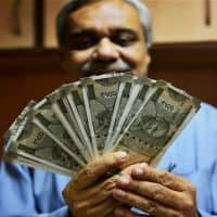 Rupee opens flat at 66.96 per dollar