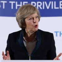 UK PM Theresa May rejects calls to relax Indian visa rules