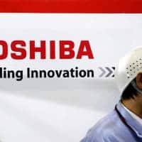 Bain, Permira interested as Toshiba flags chip biz stake sale