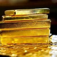 Gold rises to 2 mth high on Trump policy uncertainty,dollar drop