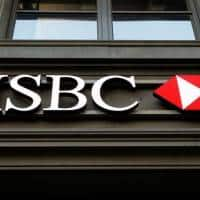 HSBC share run stumbles on writedowns, tough outlook