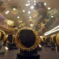 Gold steady as investors look for rate hike clues from Fed